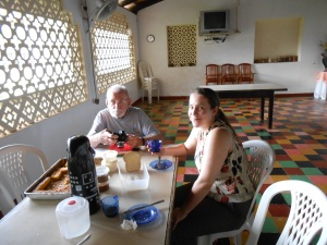 Beth and Tom sitting at the breakfast table our first morning at the farm in Itaituba.
