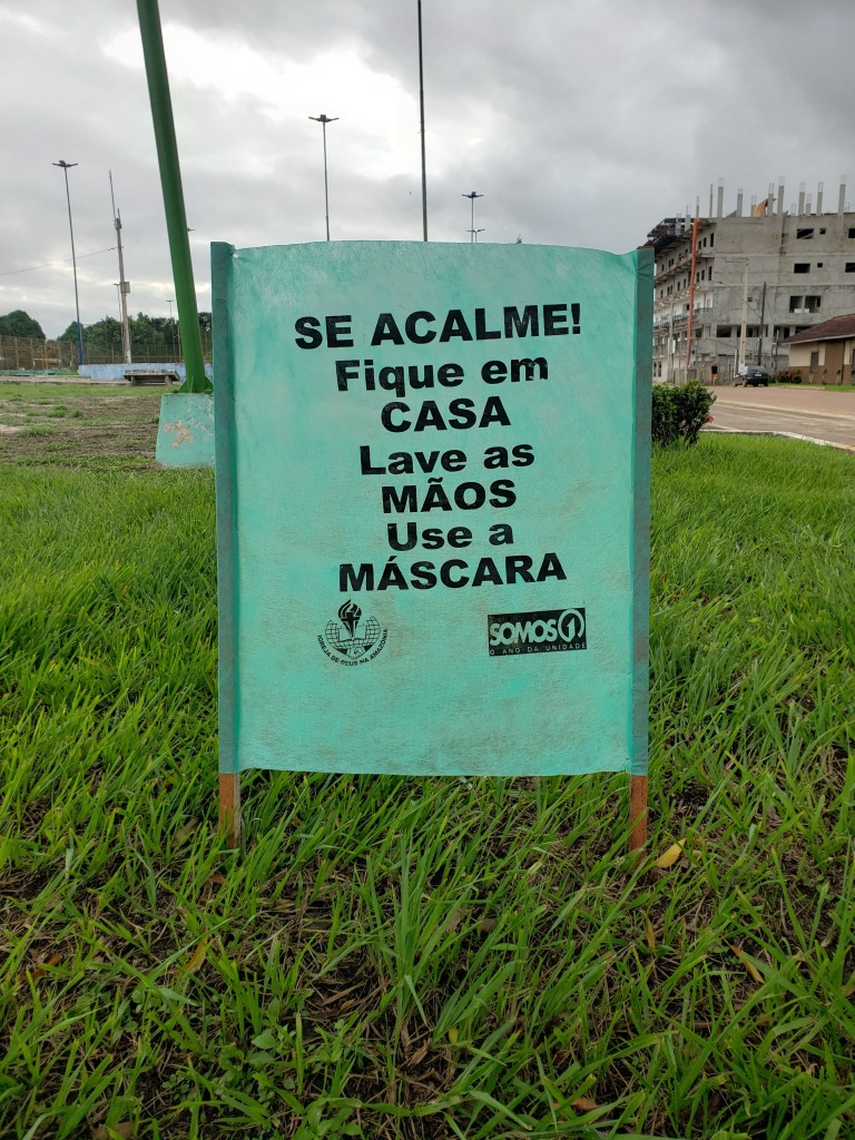 "Some of the Church of God pastors in Itaituba have been making these signs and putting them up around town. The sign says, ""Calm down! Stay in the house, wash your hands, use a mask.""  The sign features our regional Church of God logo and the logo for our regional theme this year: ""We are one."""